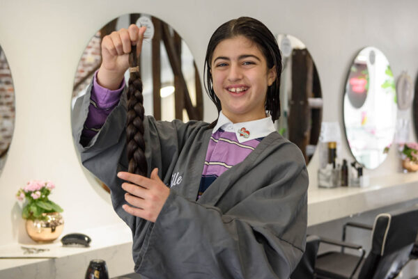 11-Year-old cuts hair at Neville Salon To raise funds for Chain of Hope
